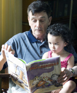 Tom&GranddaughterOnLap