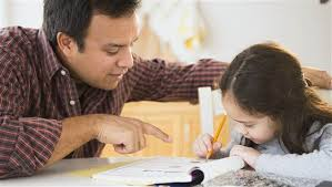 Child with parent writing